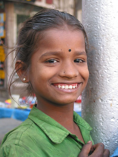 Smiling girl. Photograph by Dey Alexander. Creative Commons: Non-commercial use. Some rights reserved.